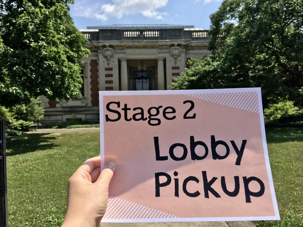 image of library with stage 2 reopening sign